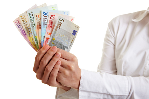 Hands offering fan of Euro money bills