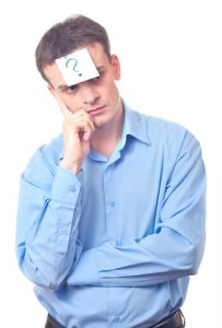 Businessman with a glued sticker with a question mark on his forehead
