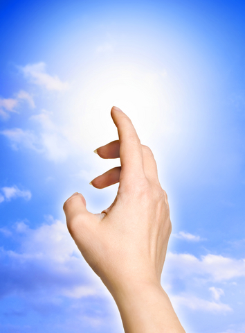 hand directed and touching Light like a concept for divine light, angel light, inner psychology, hope, soul, change etc.